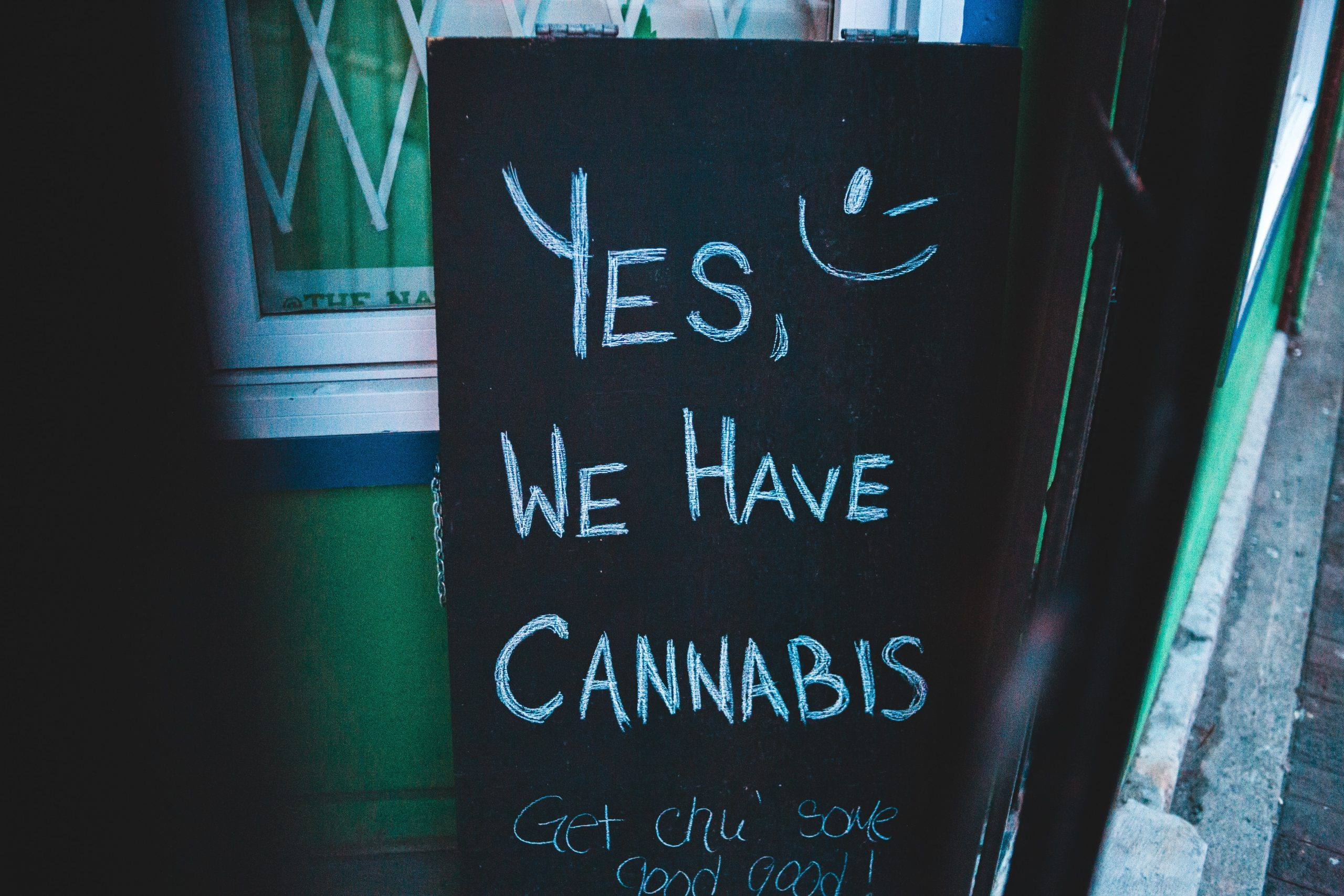 traditional marketing dispensary sign